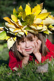 Little girl with autumn wreath on her head Royalty Free Stock Image