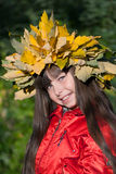 Little girl with autumn wreath on her head Stock Photo