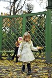 Little girl and autumn yellow leaves Royalty Free Stock Image