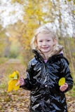 Little girl in autumnal nature Royalty Free Stock Images