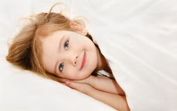 Little girl awaked up in her bed Royalty Free Stock Photo