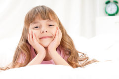 Little girl awaked up in her bed Stock Photos