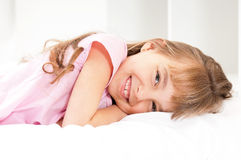 Little girl awaked up in her bed Stock Photography