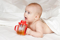 Little girl with baby bottle Stock Photo