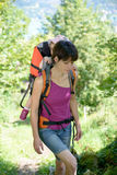 A little girl in a baby carrier walks with his mom. In the mountain Stock Images
