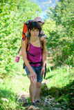 A little girl in a baby carrier walks with his mom. In mountain Royalty Free Stock Photo