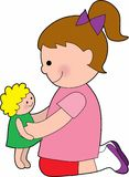 Little Girl with a Baby Doll. Little girl playing with a rag doll Royalty Free Stock Photography