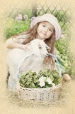 A little girl with a baby goat Stock Photography