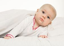 Little Girl Baby Laying Under White Blanket Stock Image