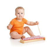 Little girl baby playing with musical toy Stock Images