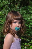 Little girl with baby,s dummy Stock Photos