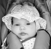 Little girl in baby-seat Royalty Free Stock Photo