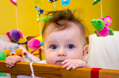 Little girl baby sitting in her bed. Little girl baby sitting in bed Royalty Free Stock Image