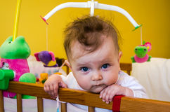 Little girl baby sitting in her bed. Little girl baby sitting in bed Royalty Free Stock Images