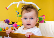 Little girl baby smiling sitting in her bed Stock Photos