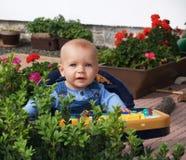Little girl in baby-walker Stock Image