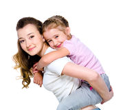 Little girl on a back of her mother Royalty Free Stock Photos