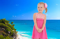 Little girl on a background of blue sea Royalty Free Stock Images