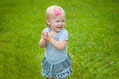 Little girl on background grass Royalty Free Stock Image