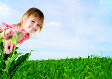 Little girl on a background a meadow Royalty Free Stock Photos