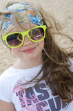 Little girl on a background of a sandy beach. Royalty Free Stock Photo