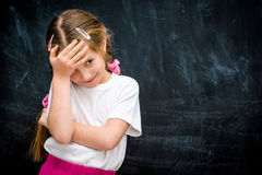 Little girl on the background of school board Stock Photo