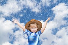 Little girl on the background of sky and snow. Stock Images