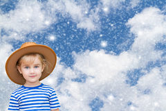 Little girl on the background of sky and snow. Royalty Free Stock Images