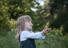 Little girl on a background of  wood Stock Image