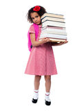 Little girl with backpack and books Royalty Free Stock Images