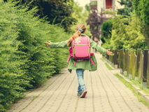 Little girl with a backpack going to school Royalty Free Stock Photography