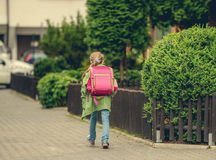 Little girl with a backpack going to school Stock Photo