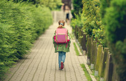 Little girl with a backpack going to school Royalty Free Stock Image
