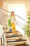 Little girl with a backpack. Stock Photo