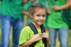 Little girl with a backpack Stock Image