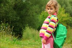 Little girl with backpack outdoor in summer Stock Photos