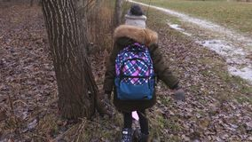Little girl with backpack after school doing nonsense stock video footage