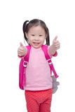 Little girl with backpack showing thumbs up Royalty Free Stock Photography