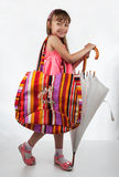 Little girl with a bag and umbrella Stock Photography