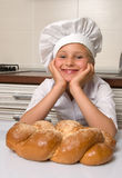 Little girl baker Stock Images