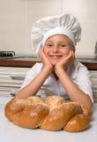 Little girl baker Stock Images