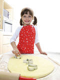 Little girl - baker Stock Photo