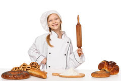 Little girl baker on kitchen with rolling pin Royalty Free Stock Images