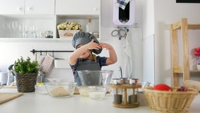 Little girl baker rolls out the dough and talking. Close up stock video