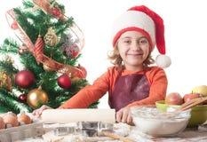 Little girl baking Stock Images