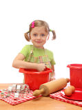 Little girl baking cakes Stock Photography