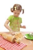 Little girl baking cakes Stock Photos