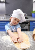 Little girl baking cakes Royalty Free Stock Photography
