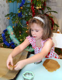 Little girl baking Christmas cookies Stock Photo