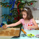 Little girl baking Christmas cookies Stock Image